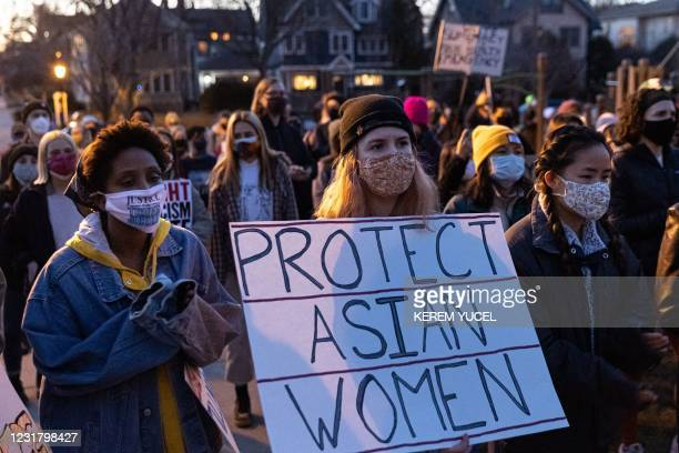 """Woman holds a sign during the """"Asian Solidarity March"""" rally against anti-Asian hate in response to recent anti-Asian crime on March 18, 2021 in..."""