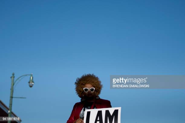 Woman holds a sign honoring the sanitation strikers on the 50th anniversary of the assassination of Martin Luther King Jr. April 4, 2018 in Memphis,...