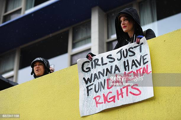 A woman holds a sign in favor of women's rights during the Women's March On Portland in Portland Oregon USA on January 21 2017 Tens of thousands...