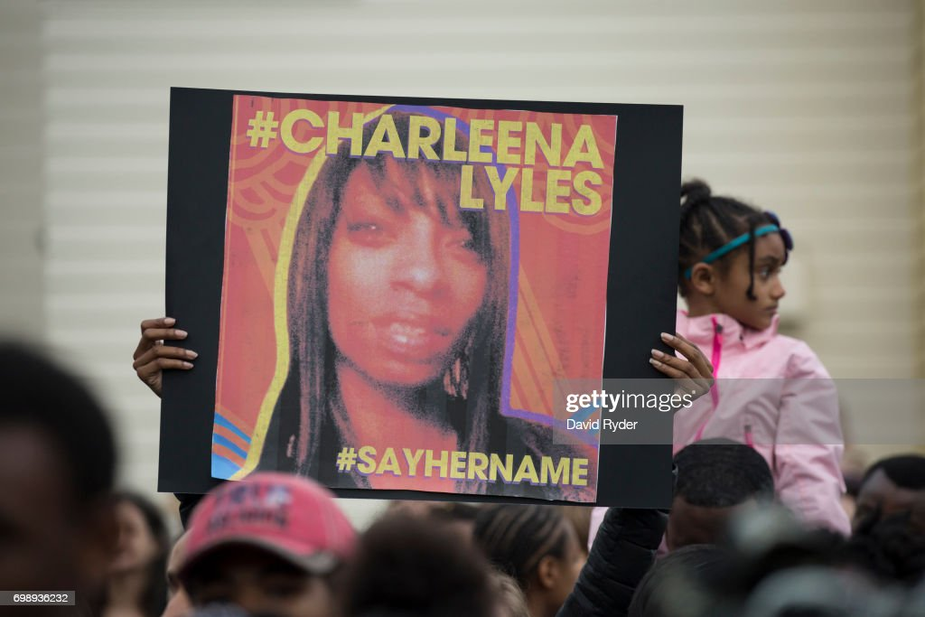 A woman holds a sign in honor of Charleena Lyles during a protest and rally in honor of Lyles on June 20, 2017 in Seattle, Washington. Officers from the Seattle Police Department shot and killed Lyles, a pregnant mother of four, on June 18.