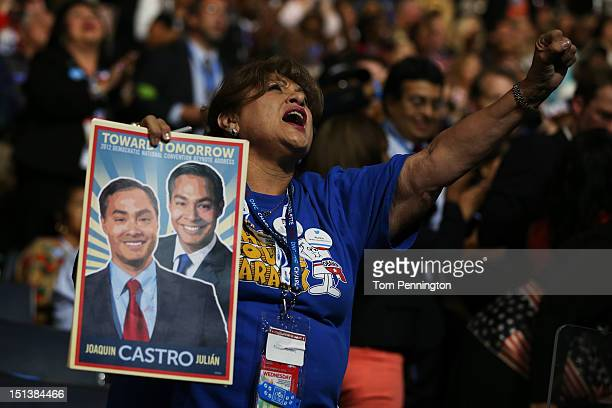 A woman holds a sign on San Antonio Mayor Julian Castro and his brother Joaquin Castro during the final day of the Democratic National Convention at...