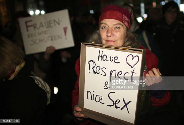 A woman holds a sign reading 'Have respect and nice sex' during a demonstration in Cologne on January 5 2016 German leaders expressed shock over...