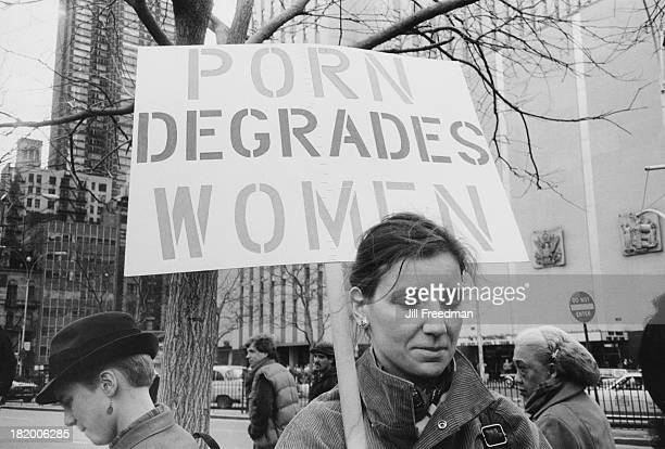 A woman holds a sign reading 'Porn Degrades Women' at an antipornography march near Times Square New York City 1984