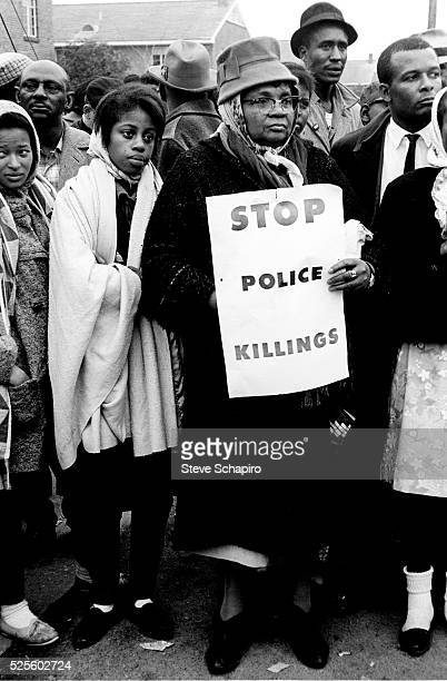 A woman holds a sign reading Stop Police Killings during the Selma Montgomery march