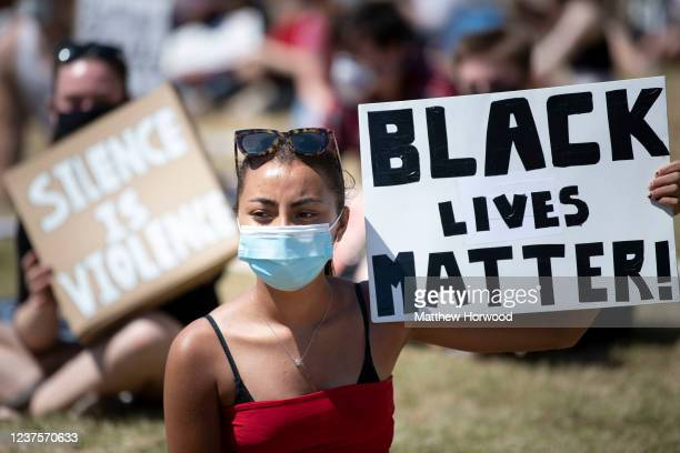 A woman holds a sign saying 'Black Lives Matter' during a protest outside Cardiff Castle in response to the death of George Floyd on May 31 in...