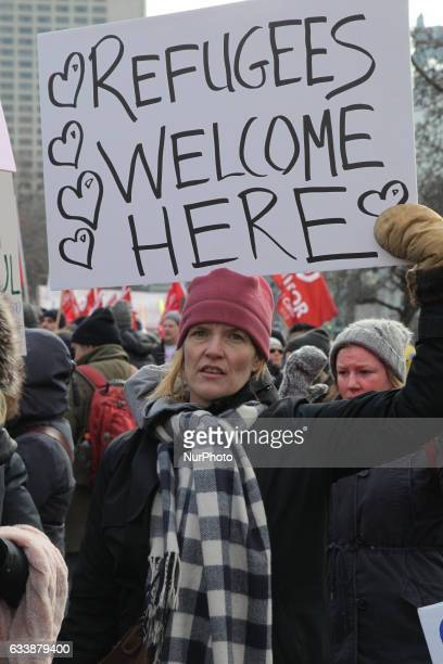 Woman holds a sign saying 'Refugees Welcome Here' as thousands of Canadians take part in a massive protest against President Trump's travel ban on...