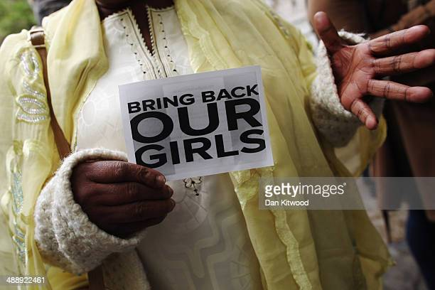 A woman holds a sign that reads 'Bring back our girls' during a protest outside Nigeria House on May 9 2014 in London England 276 schoolgirls were...
