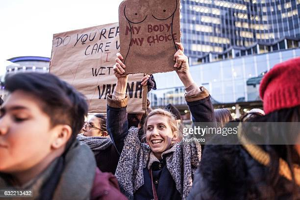 A woman holds a sign that reads quotmy body my choicequot During US president Donald Trump's inauguration speech people protest for women's rights in...