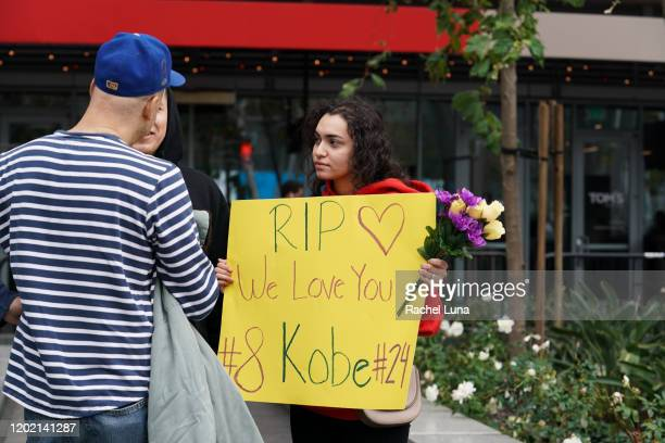 A woman holds a sign to remember retired NBA star Kobe Bryant outside the Staples Center prior to the 62nd Annual Grammy Awards on January 26 2020 in...
