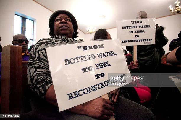 A woman holds a sign while attending a prayer service before participating in a national milelong march to highlight the push for clean water in...