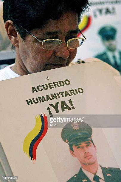 Woman holds a sign with a picture of a relative kidnapped by the Revolutionary Armend Forces of Colombia during a demonstration demanding the release...