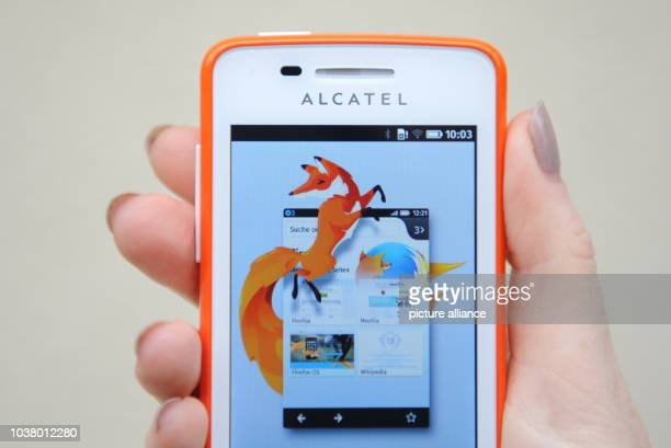 Woman holds a smartphone with the Firefox operating system during a press conference by Telekom subsidiary Congstar in Munich,Germany, 10 October...