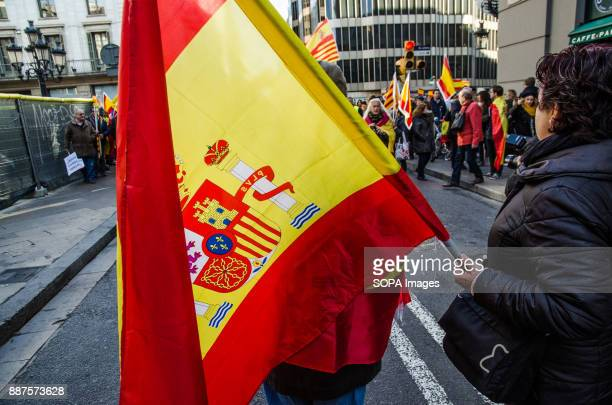 A woman holds a Spanish flag while waiting for the start of the demonstration Spain celebrates today the 39 anniversary of its Constitution This year...