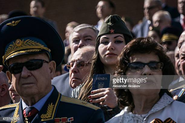 A woman holds a Ukranian passport during the Victory Parade which is part of celebrations marking the 70th anniversary of the victory over Nazi...
