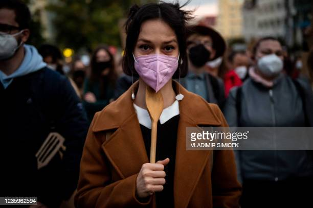Woman holds a wooden spoon during a protest against a new legislation relating abortions in Bratislava, Slovakia on October 18, 2021.
