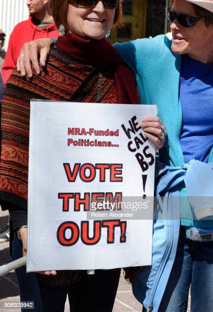 A woman holds an antiNRA sign at a 'March For Our Lives' rally in Santa Fe New Mexico The rally and march part of a nationwide series of similar...