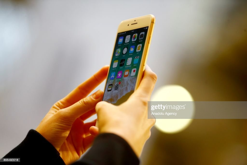 A woman holds an Apple phone in her hand after Apple launched iPhone 8 and 8 plus at the GUM department store in Moscow, Russia on September 29, 2017.