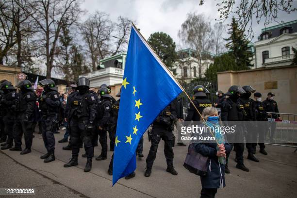 Woman holds an EU flag as people gather to protest outside the Russian Embassy on April 18, 2021 in Prague, Czech Republic. Czech Minister of Foreign...