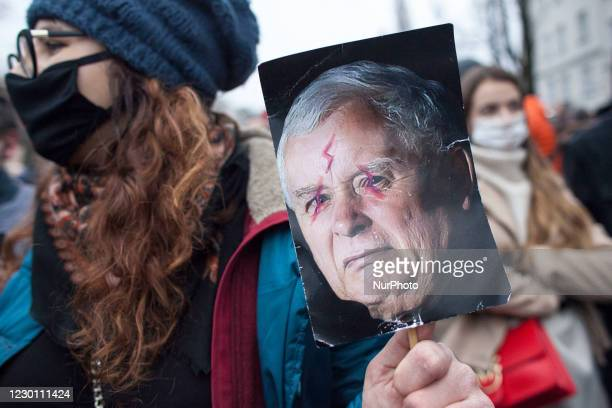 Woman holds apointed picture of Jaroslaw Kaczynski during We Are Going For Freedom We Are Going For Everything protest organized by Womens Strike and...