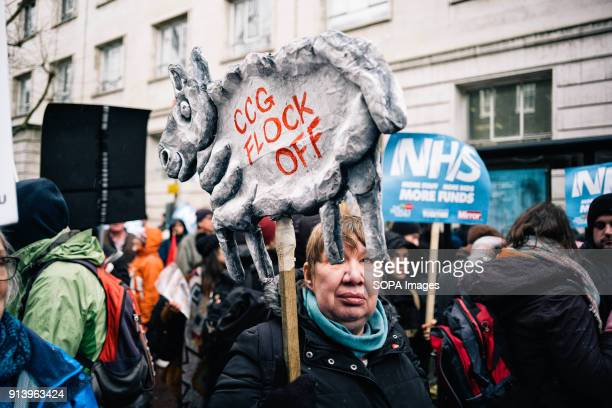 Woman holds banner shaped like sheep Thousands of demonstrators amassed in London on Saturday to garner support for higher NHS funding as the worst...