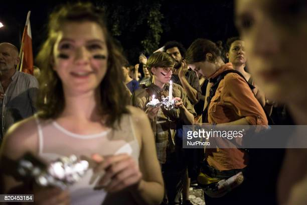 Woman holds candle during blockade of Polish Parliament after the vote on new way of electing judges to Supreme Court in Warsaw on July 20 2017