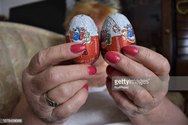 A woman holds chocolate eggs with surprise toys in Ankara Turkey on December 28 2018 Turkey's Ministry of Trade announced on December 28 that all the...