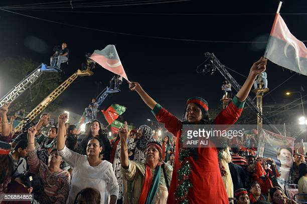 Woman holds flags of opposition party Pakistan Tehreek-e-Insaf as she attends an anti-government rally in Lahore on May 1 on the Panama Leaks issue....