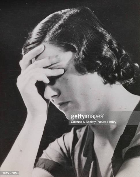 Woman holds head 192060 Photographic archive of Photographic Advertising Limited Comprising stock sheets individual images guard books promotional...