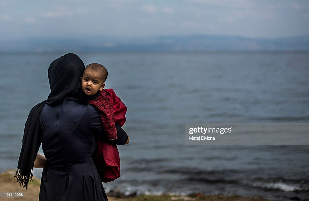 Migrants Arrive On The Beaches Of Lesbos Having Made The Crossing From Turkey : News Photo