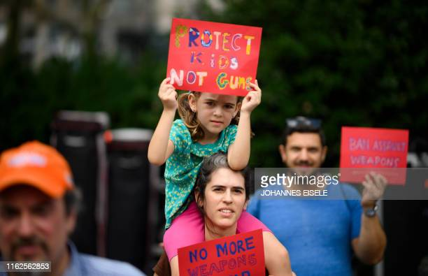 Woman holds her child as she takes part in a rally of Moms against gun violence and calling for Federal Background Checks on August 18, 2019 in New...