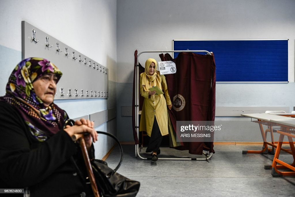 A woman holds her filled ballot as she readies to vote at a polling station in snap twin Turkish presidential and parliamentary elections in Istanbul on June 24, 2018. - Turks began voting in dual parliamentary and presidential polls seen as the President's toughest election test, with the opposition revitalised and his popularity at risk from growing economic troubles.
