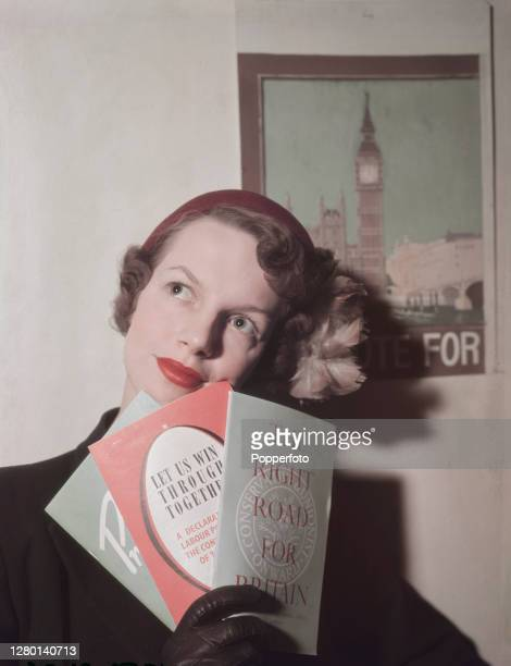 A woman holds manifesto publications published by from left the Liberal Party Labour Party and Conservative and Unionist Party issued ahead of the...