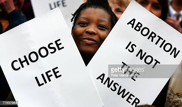 A woman holds placards during an antiabortion rally near Parliament on October 27 2007 in London Antiabornionists are marking the 40 years since...