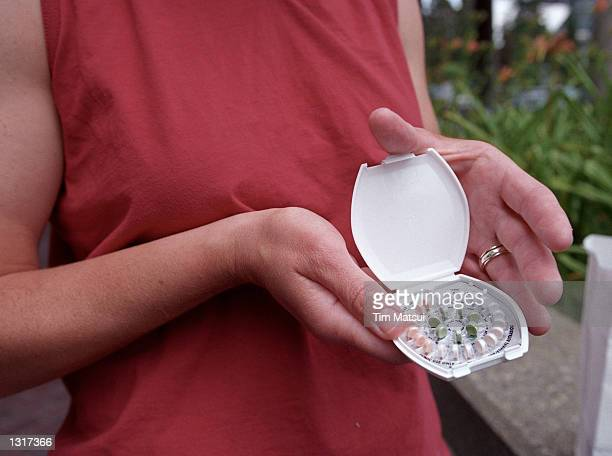 A woman holds prescription contraceptives June 13 2001 in Seattle Washington A federal judge ruled on that Bartell Drug Co which operates 50 drug...