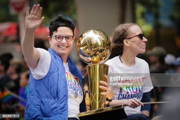 Woman holds the NBA's Larry O'Brien Championship Trophy while riding in a car in the annual LGBTQI Pride Parade on Sunday, June 25, 2017 in San...