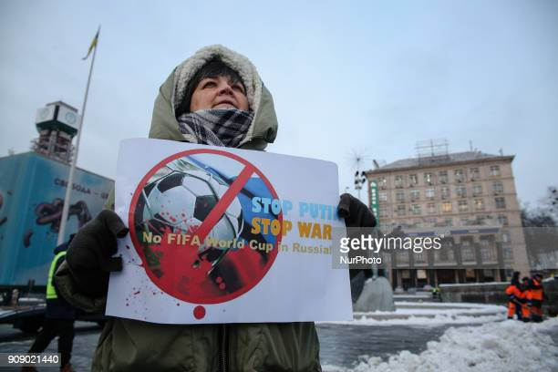 A woman holds the placard during the quotStop Putin Stop warquot rally and quotKick Out Putinquot flashmob at the Independence Square in Kyiv Ukraine...