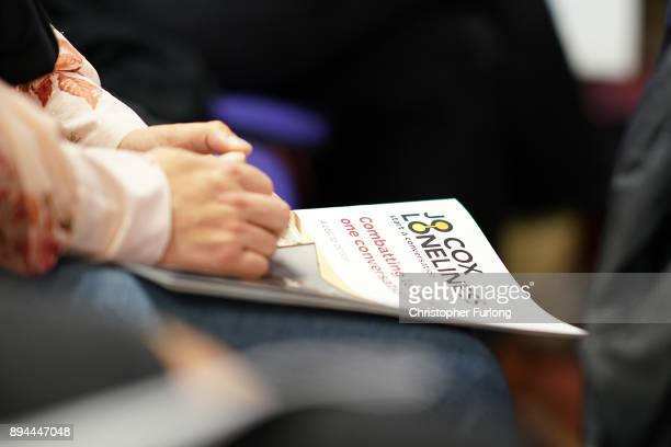 A woman holds the report of the Jo Cox Commission on December 15 2017 in Batley England The commission was set up by Jo Cox MP before her murder last...