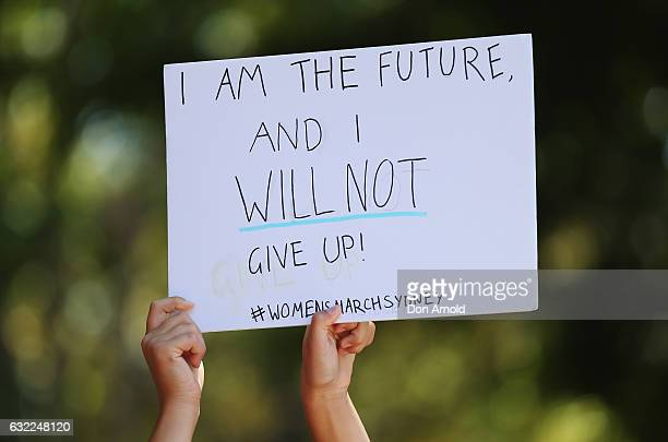 A woman holds up a banner in Hyde Park on January 21 2017 in Sydney Australia The marches in Australia were organised to show solidarity with those...
