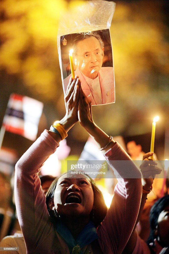 A woman holds up a photograph of Thailand's King Bhumibol Adulyadej outside the Siriraj Hospital on December 5, 2009 in Bangkok, Thailand. Adulyadej has been King since 1946 and is now Thailand's longest serving monarch. He was admitted to hospital several months ago with flu like symptoms but was discharged in time to celebrate his birthday celebrations today.