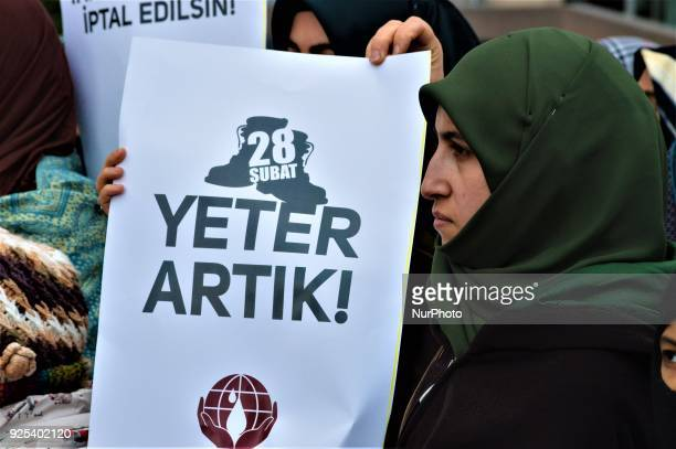 A woman holds up a placard as an organized group of proIslamic demonstrators makes a statement outside the main courthouse on the 21th anniversary of...