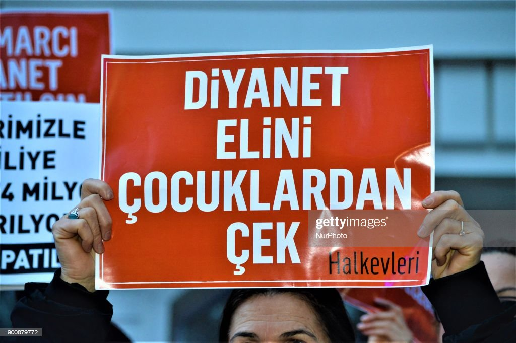 A woman holds up a placard as demonstrators gathered to protest against Turkey's Presidency of Religious Affairs in Ankara, Turkey on January 3, 2018. The Turkish Presidency of Religious Affairs has stated on its official website that 9-year-old girls and 12-year-old boys are able to get married, the opposition media claimed on January 2.