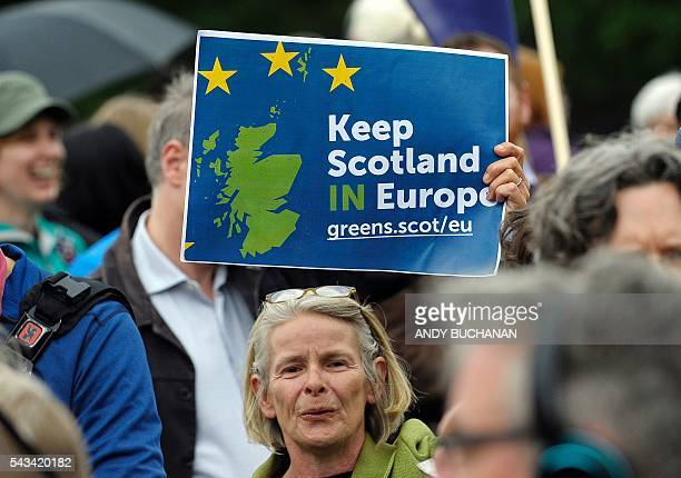 A woman holds up a placard at a demonstration by Pro EU campaigners outside the Scottish Parliament ahead of a debate on the EU Referendum result and...