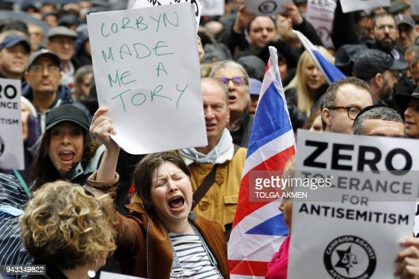 A woman holds up a placard declaring Corbyn made me a Tory as she joins protesters gathering for a demonstration organised by the Campaign Against...