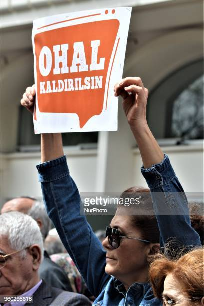 A woman holds up a placard during a demonstration staged by the main opposition Republican People's Party protesting the state of emergency on the...