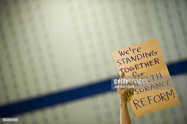 A woman holds up a placard during a healthcare forum with US Congresswoman Donna Edwards DMD in Germantown MD August 25 2009 AFP PHOTO/Jim WATSON