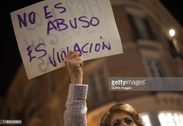 A woman holds up a placard during the demonstration Demonstration in support of the young woman who was raped by five men in Manresa In October of...