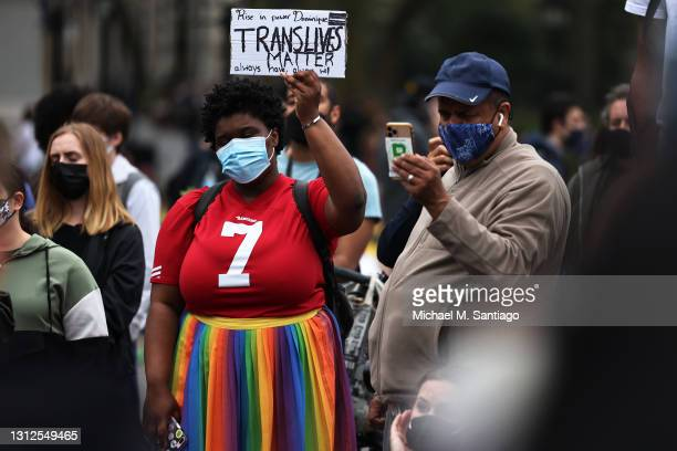 Woman holds up a sign during a vigil for Daunte Wright and Dominique Lucious at Washington Square Park in Manhattan on April 14, 2021 in New York...