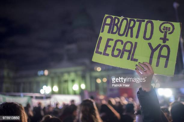 A woman holds up a sign that reads 'Legal abortion now' during a rally to demand legal and free abortion at Congressional Plaza on June 13 2018 in...