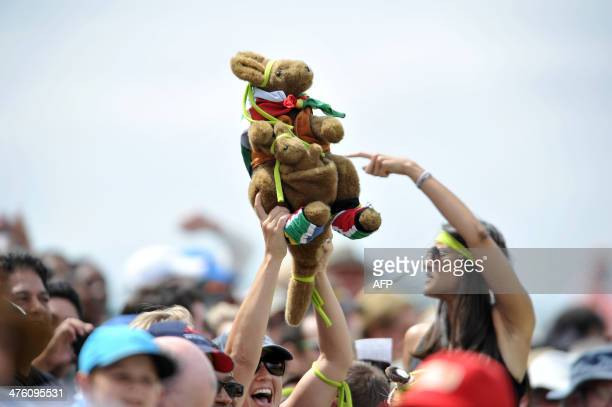 A woman holds up a stuffed kangaroo on the second day of the third Test cricket match between South Africa and Australia at Newlands in Cape Town on...