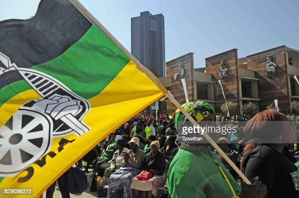 A woman holds up an ANC flag during the Womens Day march at Lillian Ngoyi Square on August 09 2017 in Pretoria South Africa The day marked 61 years...